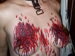 Very hot wax on breasts