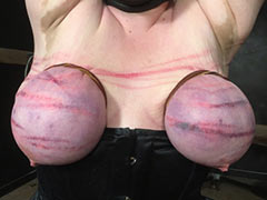 Caning of tied tits