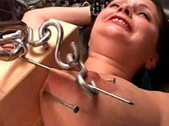 Pricking of squeezed breasts
